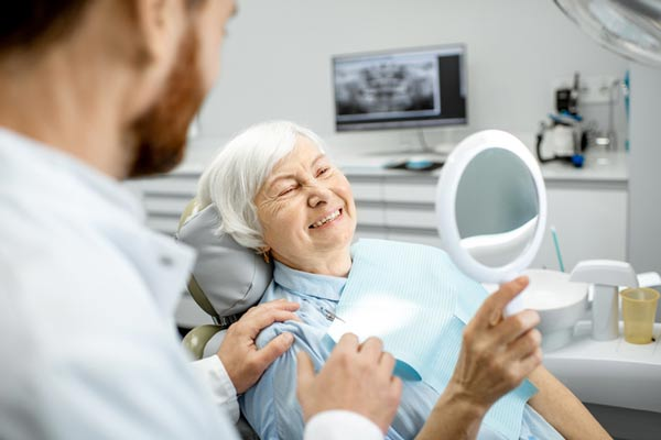 Elderly woman enjoying her new smile